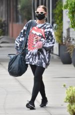 Ashlee Simpson Dons a colorful Rolling Stones-inspired sweater in Studio City