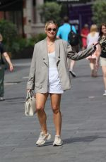 Ashley Roberts Looks summary in white shorts and top with blazer at Heart radio in London