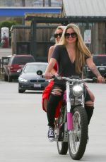 Avril Lavigne Was seen taking her friend for an electric motorcycle ride on Memorial Day in Malibu
