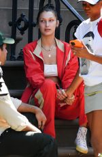 Bella Hadid Wears a red track suit in New York City