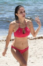 Bethenny Frankel Wears a hot pink bikini and her enormous engagement ring as she hits the beach in Miami