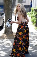 Caprice Steps out in a thigh high split floral dress on her way to meet friends for lunch in London