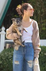 Cara Santana Carries her dog during a low-key outing in Los Angeles