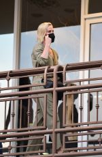 Charlize Theron Sports a khaki jumpsuit as she is spotted arriving at upscale sushi park restaurant in Los Angeles