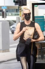Charlize Theron Takes her daughter to Fatburger for some takeout in Sherman Oaks