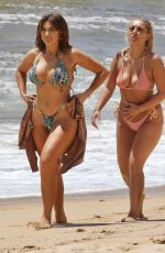 Chloe Ferry With bestie Bethan Kershaw wearing her skimpy snakeskin printed bikini as Bethan donned her sultry orange bikini as the pair hit the beaches of Portugal