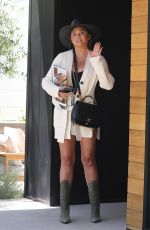 Chrissy Teigen Shares a smile as she arrives at her office in Los Angeles