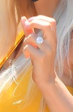 Courtney Stodden Rocks a massive rock on her finger as she is seen with her fiance Chris Sheng for the first time since getting engaged in Disneyland
