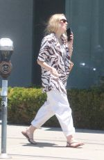 Dakota Fanning Is all smiles going to grab a cold beverage in West Hollywood