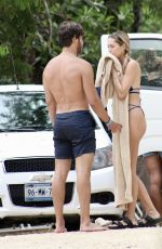 Delilah Hamlin Looks stunning in a skimpy blue bikini as she visits a natural swimming hole in Tulum with friends