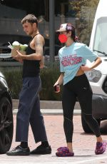 Dua Lipa Out & about with her boyfriend with iced beverages from Starbucks in Los Angeles
