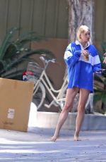 Elsa Hosk Chats with a construction worker outside of her Los Angeles home