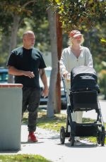 Elsa Hosk Takes a walk with her baby and a male friend near her home in LA