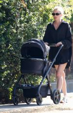Elsa Hosk Wears a black tuxedo shirt while on a stroll with her daughter in Pasadena