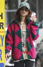 Emily Ratajkowski Pictured speaking to someone on her iPhone in Sohob wearing a colorful coat