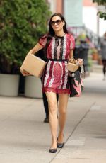 Famke Janssen Returns home in a patchwork lace dress from the Post Office with two boxes in New York City