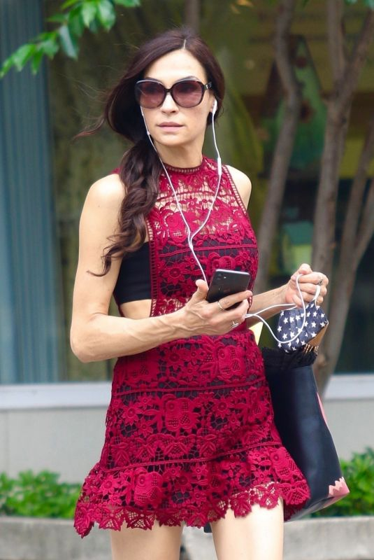 Famke Janssen Steps out in red mini dress while braving the heatwave in New York