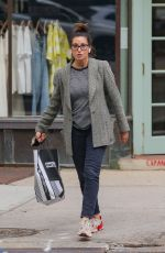 Gina Gershon Seen taking a stroll after some shoe shopping at Footlocker in New York