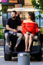 Ilana Glazer Relies on a golf cart for transport as she arrives with husband David Rooklin to the Tribeca Film Festival in New York