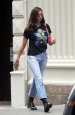 Irina Shayk Dons a vintage black tee with torn jeans and black leather boots while out running errands in New York