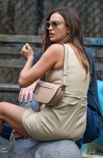 Irina Shayk Looks stunning in a beige mini dress while out for a stroll in New York