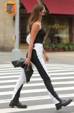 Irina Shayk Seen wearing a black and white outfit in New York