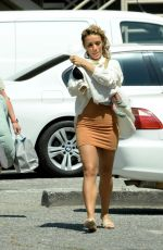 Jena Frumes Cradles her baby for a photo op in Los Angeles