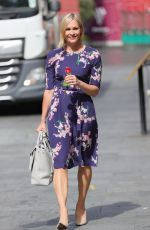 Jenni Falconer Looks pleased as punch after she receives a red rose from a waiter at Smooth radio in London