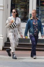 Kacy Byxbee Stops for some beverages while shopping around Manhattan's Soho area