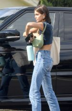 Kaia Gerber Cuts a casual figure in jeans and a striped crop top as she arrives at a photoshoot