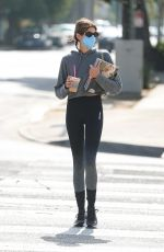 Kaia Gerber Picks up coffee and grabs a handful of magazines after her morning workout in West Hollywood