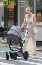 Karlie Kloss Looks stunning as she takes a stroll with her baby Levi in New York