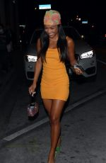 Karrueche Tran As she stands out in a yellow dress and bold head scarf while stepping out for a night at the Highlight Room in West Hollywood
