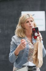 Kate Garraway Is glued to her phone after an appearance at the Smooth radio in London