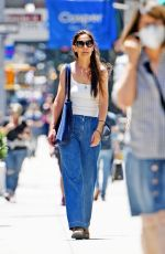 Katie Holmes Enjoys a stroll with a mystery man in New York