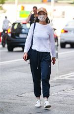 Katie Holmes Leaves her apartment in cozy fashion on a 93 degrees day in New York