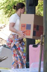 Katie Price Is seen starting to move belongings back into her Sussex mansion