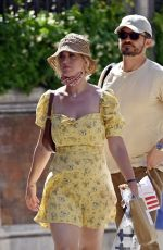Katy Perry Nearly suffers a Marilyn Monroe moment while spending quality time with fiance Orlando Bloom in Venice