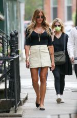Kelly Bensimon Flashes a smile and the peace sign as she is pictured out with her colleague Josh Tepper in New York City