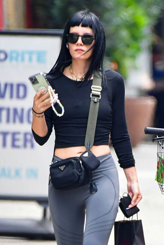Lily Allen Checks on her phone while out shopping in Manhattan