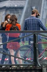 Lily Collins and Charlie McDowell are seen on the set of