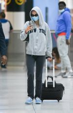 Lily Rose Depp Keeps it low key in a grey hoodie and sunglasses as she arrives at JFK Airport in NYC