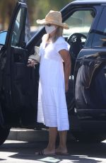 Lori Loughlin Gears up for summer in a floaty white sundress and straw hat in Los Angeles