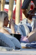 Lottie Moss Having a drink and a smoke while enjoying a sunset in Mykonos