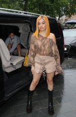 Mabel Pictured looking chic at Global offices in brown shorts and camouflage top in London