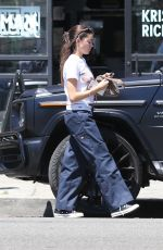 Madison Beer Opts for a cozy pair of Dickies pants while out shopping in Los Angeles
