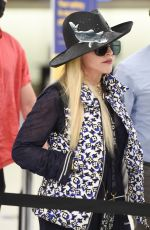 Madonna Arrives at JFK Airport with a quirky fish hat in New York