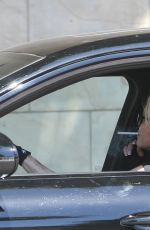 Melanie Griffith Puffs on what appears to be a cigarette after the star left her Thursday gym session in Los Angeles