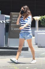 Mila Kunis Brings her stripes and jean shorts out in sunny Beverly Hills