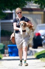 Mischa Barton Steps out carrying her dog to run an errand in Los Feliz